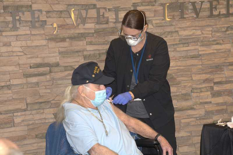 COURTESY PHOTO: CONSONUS PHARMACY - Ed Johann, a veteran who served in Pearl Harbor, was one of the first to receive a new COVID-19 vaccine Monday, Dec. 21.