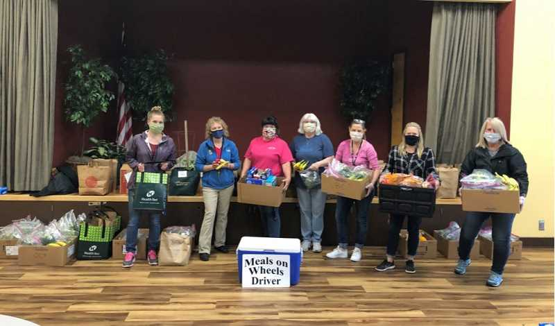 COURTESY PHOTO: CITY OF OC - Pioneer Center Meals on Wheels drivers get ready to deliver food boxes to homebound seniors throughout Oregon City. The program has received cash donations from citizens, plus food donations from Winco, Pure Bliss Bakery and other businesses.