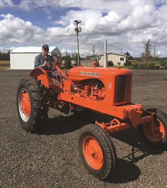 COURTESY PHOTO: CASALE FAMILY - Joe Casale with one of the vintage Allis-Chalmers tractors that were recently donated to the NWREC in Aurora.