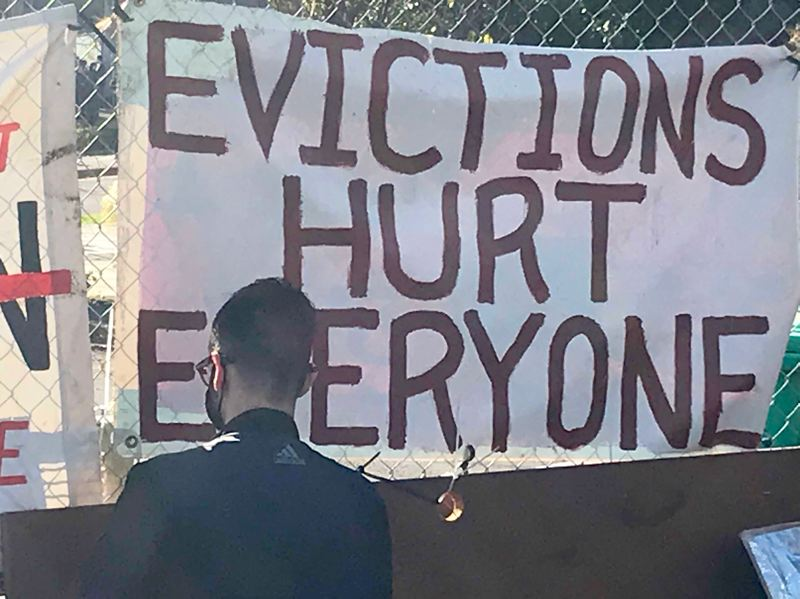 PMG PHOTO: ZANE SPARLING - A banner decrying recent eviction efforts in Portland was hung near a barricade in North Portland.