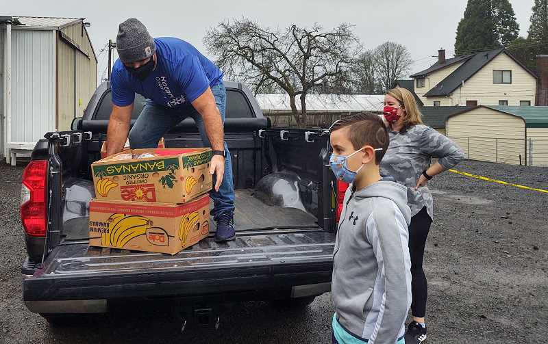 COURTESY PHOTO - Oregon City Rotarian Brian Nava collects Oregon City Elks Lodge Christmas boxes on Dec. 19 to deliver to local families in need. Seven Rotarians and their families helped Elks members deliver 420 food boxes.