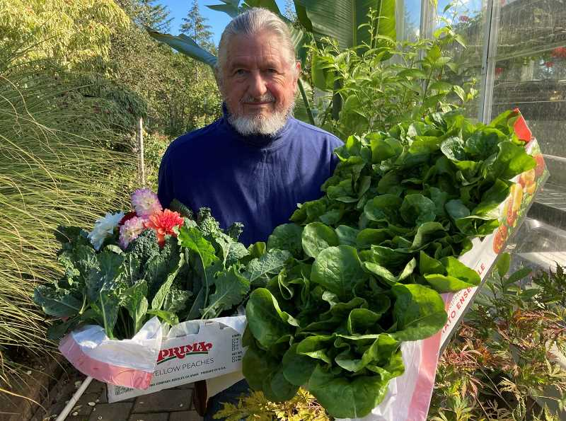 COURTESY PHOTO - Will Hughes represents all of the Master Gardeners who reported individually the donations that they made to food pantries in Clackamas County, which totaled to 5,000 pounds of produce in 2020.