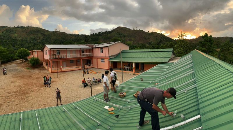 COURTESY PHOTO: BRIGHTEN HAITI - Workers begin to install solar panels on an elementary school in Durissy, Haiti.