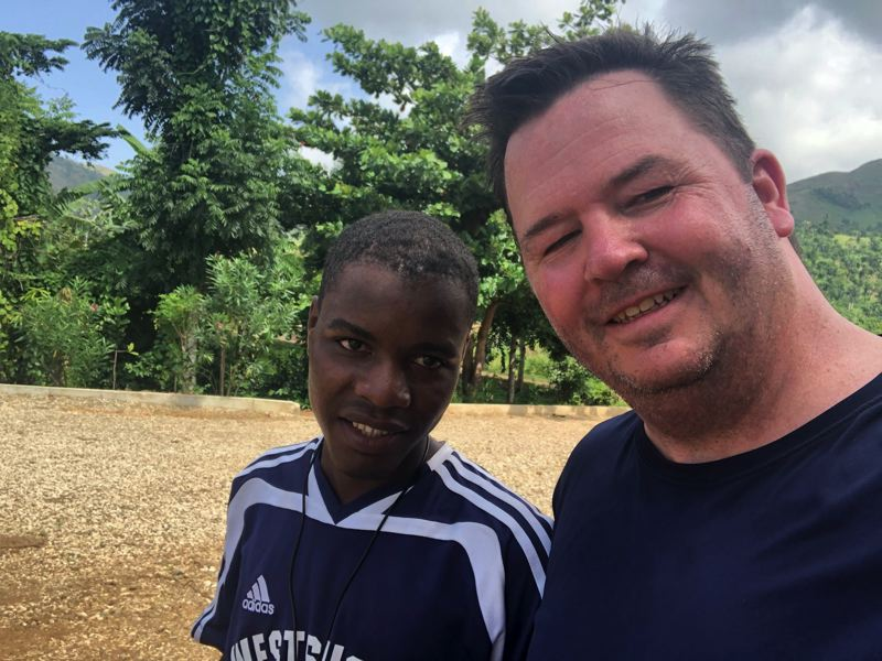 COURTESY PHOTO: BRIGHTEN HAITI - Brighten Haiti founder Kevin Keene with an 11th-grade student from Durissy, Haiti, where the nonprofit is working to provide solar panels.
