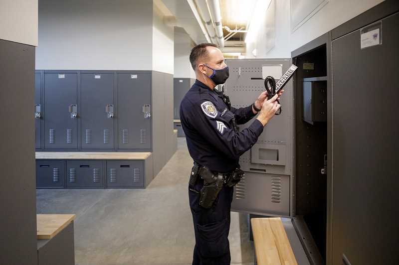 PMG PHOTO: JONATHAN HOUSE - Beaverton Police Sgt. Kevin McDonald checks out the locker room in the new Beaverton Public Safety Center.