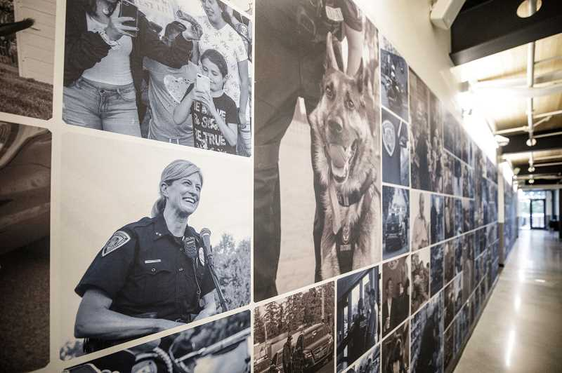 PMG PHOTO: JONATHAN HOUSE - A wall of photography adorns a hallway in the new Beaverton Public Safety Center.