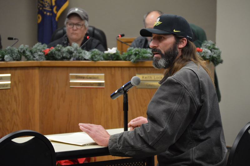 PMG FILE PHOTO - St. Helens Mayor Rick Scholl speaks during a public hearing in December 2018. In spring 2020, Scholl found himself in the uncomfortable position of trying to defuse controversy over city officials' reaction to the idea of letting homeless residents shower at McCormick Park while still not endorsing the pitch himself.