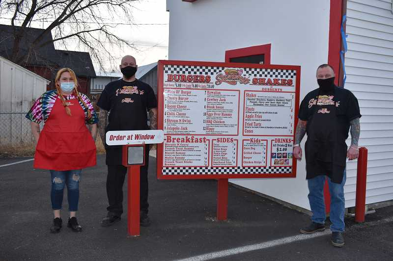 RAMONA MCCALLISTER - Sammy's Burgers & Shakes will open for business on Dec. 30. Pictured from left are three of the cooks at the new restaurant: Jordan Adams, Jaccob Nordquist and Shawn Baggenstos.