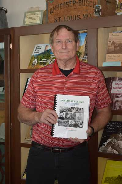 "RAMONA MCCALLISTER - Bowman Museum Historian Steve Lent displays his newest volume of ""Monuments in Time,"" the third of a series of stories that run in his weekly newspaper column."