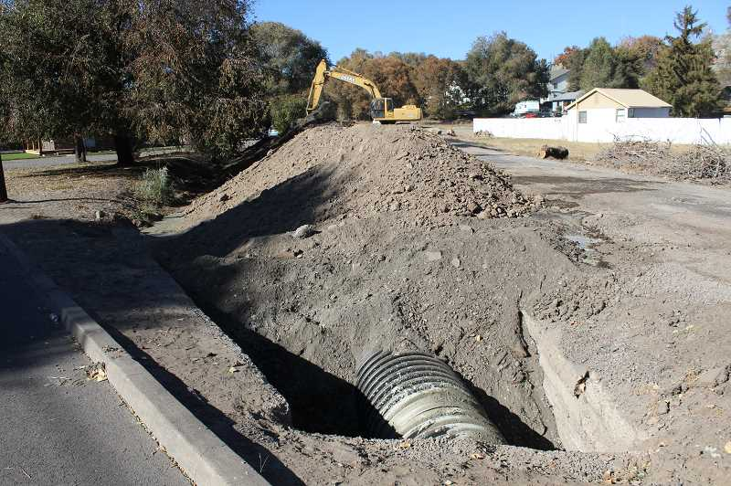 CENTRAL OREGONIAN - Portions of canal have already been piped in Northeast Prineville. More piping is planned throughout the irrigation district.