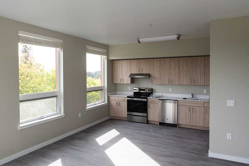 STAFF PHOTO: CHRISTOPHER OERTELL - Stainless steel GE appliances are among the fixtures and features installed in units at the Jesse Quinn Apartments, an example of an affordable housing project in downtown Forest Grove.