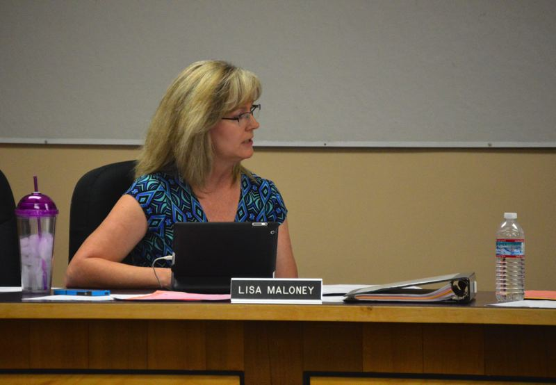 PMG PHOTO: MARK MILLER - School Board member Lisa Maloney speaks in opposition to renewing the Scappoose School District's human sexuality curriculum during a July 2015 meeting.