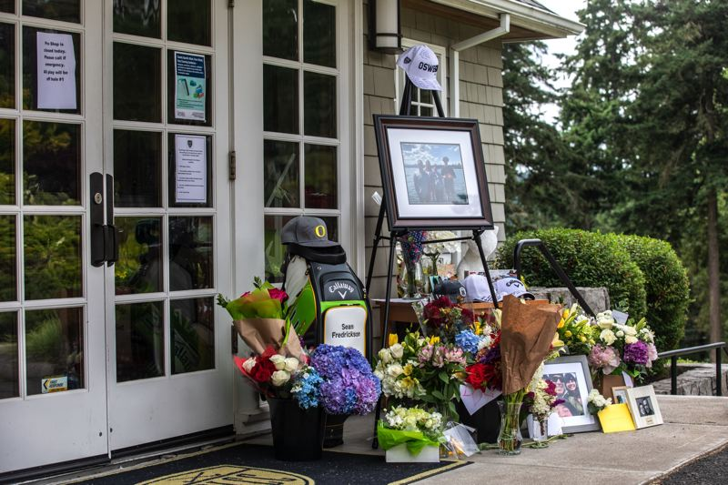 PMG FILE PHOTO - A memorial was placed outside of Oswego Lake Country Club in honor of four Lake Oswego family members that died in a plane crash over Fourth of July weekend.