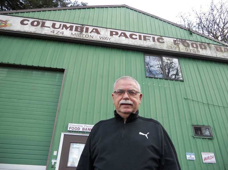 PMG PHOTO: SCOTT KEITH - Columbia Pacific Food Bank Executive Director Casey Wheeler stands in front of his food bank in St. Helens.