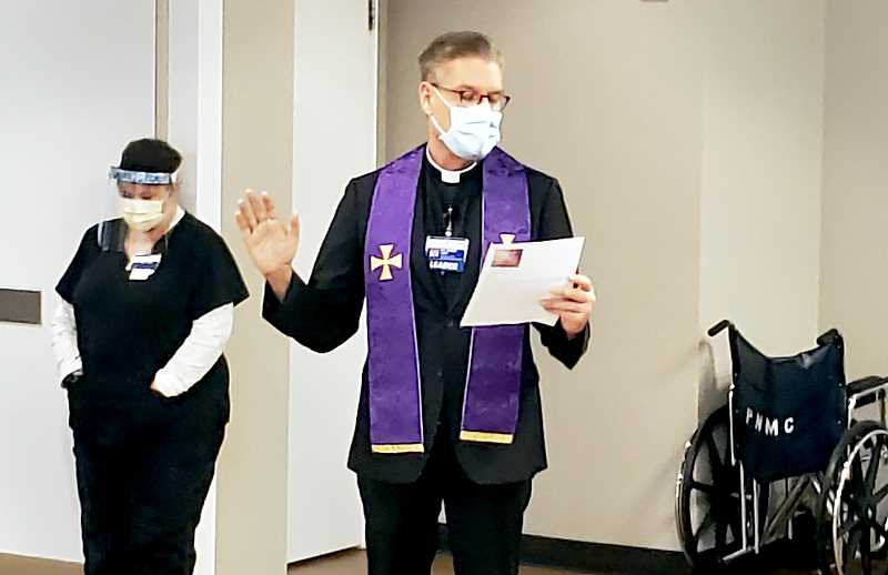 COURTESY PHOTO: PNMC - Father Chris Fabre, the facility's spiritual leader, offered a blessing prior to the inocluations.