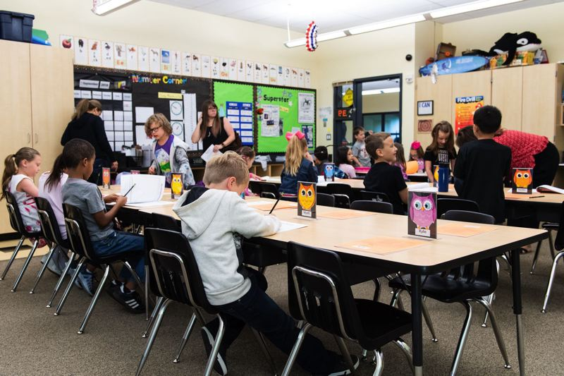 PMG FILE PHOTO - Orenco Elementary School students in Julia Snyder's second-grade class get settled and fill out a worksheet on the first day of school in 2019.
