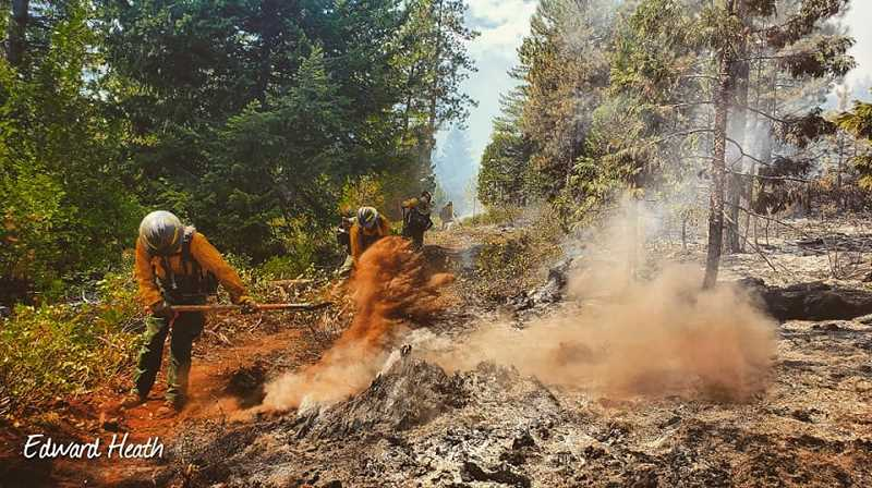 EDWARD HEATH/FOR THE PIONEER  - Firefighters work the line at a fire on the Warm Springs Reservation. Two fires, the P-515 and the Lionshead, burned thousands of acres on the reservation from August to October.