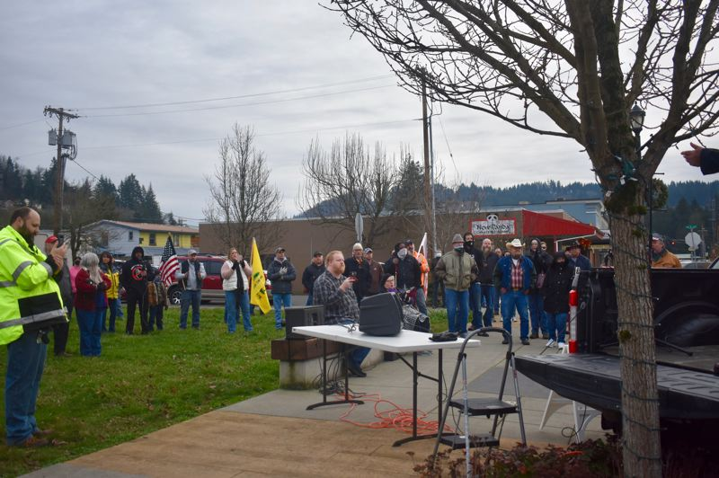 PMG PHOTO: EMILY LINDSTRAND - Residents of Estacada, Sandy and Molalla attended an 'Open Oregon' rally in downtown Estacada on Tuesday, Dec. 29.