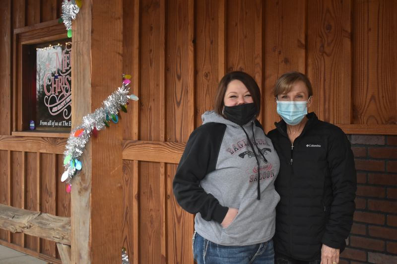 PMG PHOTO: EMILY LINDSTRAND - Megan Freauff  and Liz Mitchell of the Eagle Creek Saloon will open their doors for reduced indoor dining as part of the 'Open Oregon' movement.