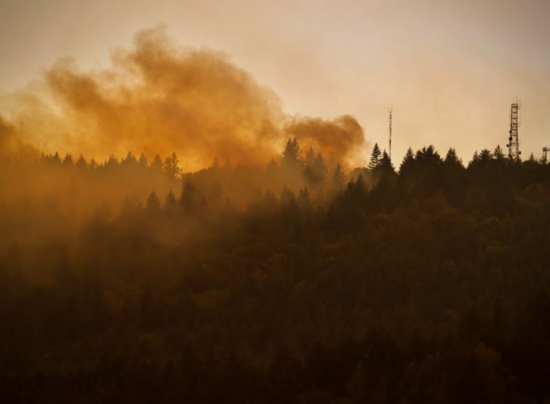 PMG PHOTO: JAIME VALDEZ - Fumes of smoke rise from the Chehalem Mountain-Bald Peak Fire near Newberg in September. The wildfire prompted hundreds of evacuations in rural Washington and Yamhill counties.