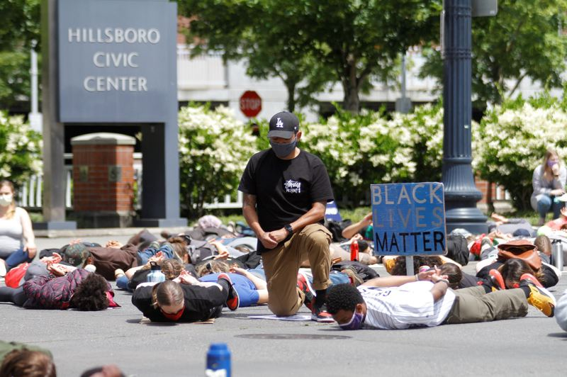 PMG PHOTO: WADE EVANSON - Protesters outside the Hillsboro Civic Center stage a die-in in memory of George Floyd in June. Demonstrations in Washington County werent nearly as frequent or boisterous as in Portland, never devolving into physical clashes with police, but they made their presence known even well into fall.