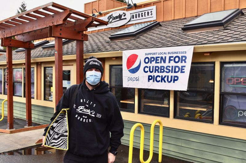 PMG PHOTO: BRITTANY ALLEN - Preston Watts, manager of Bradys Burgers and Brats, wishes his restaurant could reopen for indoor dining, but he's been happy to see more people coming in for takeout or calling for delivery.
