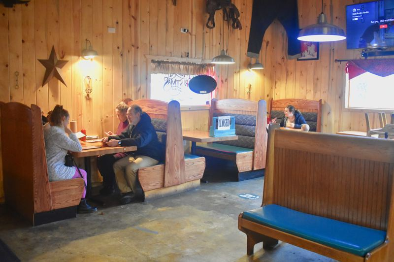 PMG PHOTO: EMILY LINDSTRAND   - Multiple tables at Eagle Creek Saloon were closed to facilitate social distancing when the establishment's dining room reopened Friday, Jan. 1.
