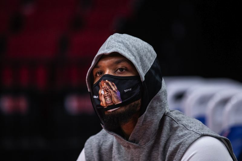 COURTESY PHOTO: BRUCE ELY/TRAIL BLAZERS - Damian Lillard, seen here chlling with a mask on earlier in the season, scored 34 points against the Golden State Warriors on Friday in the first of two games in his home area. He's from Oakland, California.