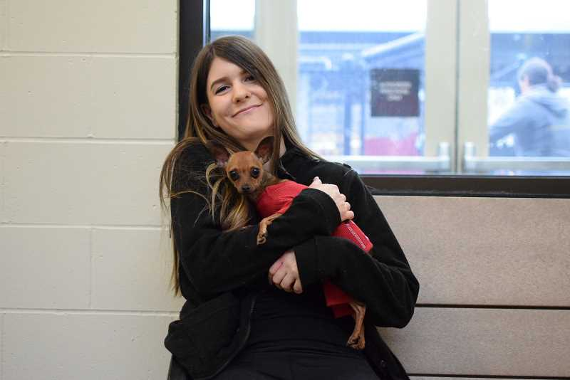 COURTESY PHOTO: OREGON HUMANE SOCIETY - Brittany Grenfell said she fell in love with Nelson when she saw him in Oregon Humane Society kennel. She was first in line Monday, Dec. 3, to adopt Nelson. OHS sets goals of adopting out 11,000 pets a year, but pandemic issues precluded hitting that goal in 2020.