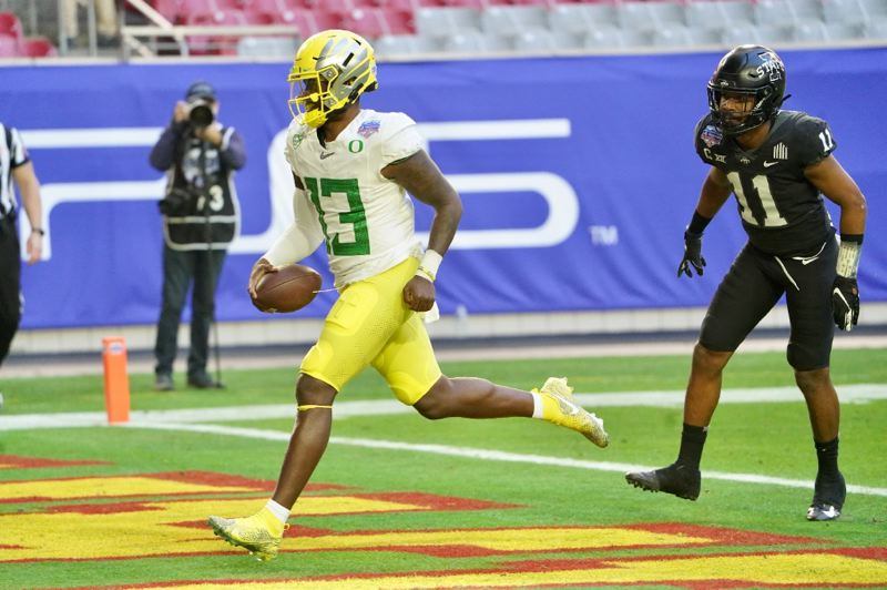 COURTESY PHOTO: PLAYSTATION FIESTA BOWL - Anthony Brown ran 16 yards for this second-quarter touchdown that was the last for the Ducks in Saturday's loss to Iowa State.