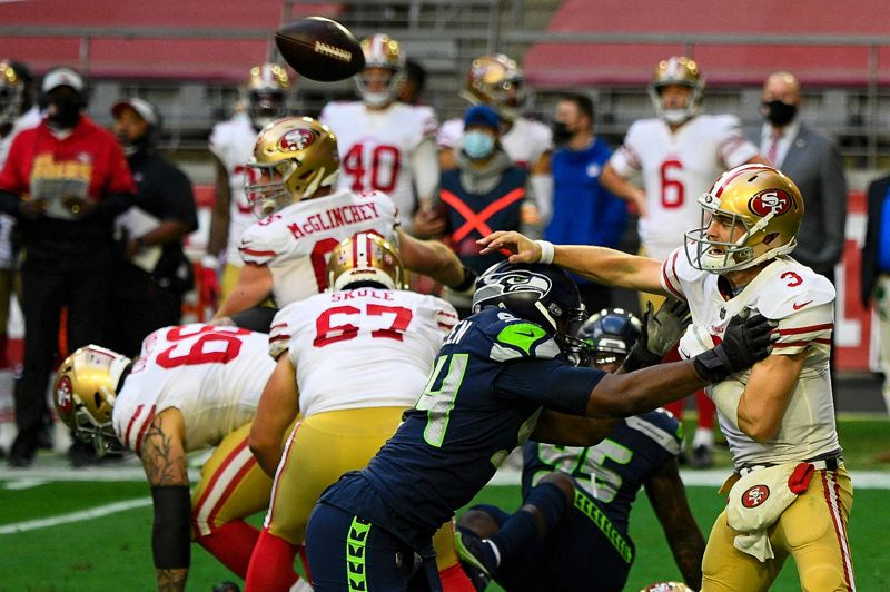COURTESY PHOTO: MICHAEL WORKMAN - Seattle's Rasheem Green presures San Fancisco quarterback C.J. Beathard during the Seahawks 26-23 win over the 49ers.