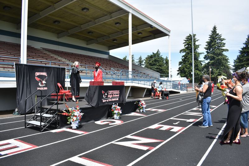 PMG PHOTO: TERESA CARSON - This masked, socially-distanced graduation for Centennial High School captures how the coronavirus pandemic changed almost everything in 2020.
