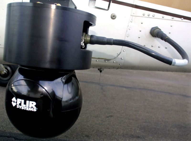 PMG PHOTO: LEILA NAVIDI - Among its many products, FLIR specialized in infrared imaging systems such as this one affixed to the side of a Cessna 172 airplane that the police use to track criminals from the air.