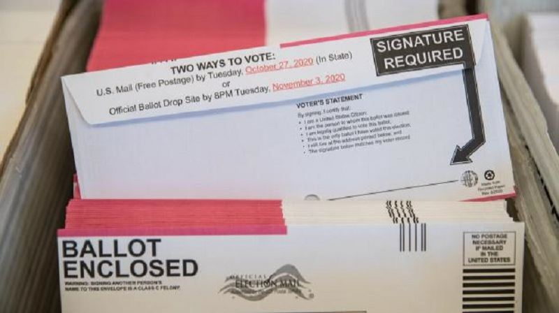 COURTESY PHOTO: KOIN 6 NEWS - Oregon vote by mail ballot envelopes in an elections center.