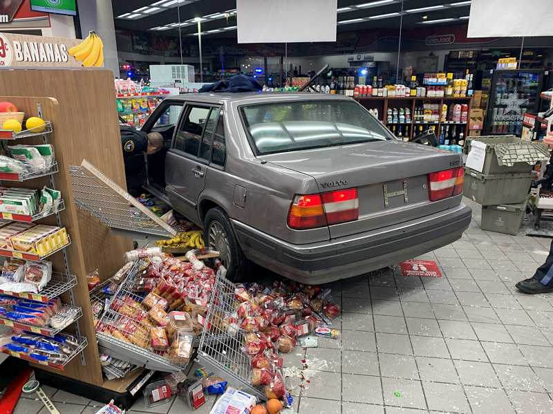 COURTESY PHOTO: TUALATIN POLICE DEPARTMENT - Police deployed spike strips before a vehicle crashed into the Jackson Food Store on Southwest Nyberg Road early Tuesday morning, arresting a Seattle-area man.