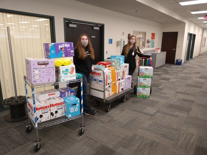 COURTESY PHOTO: ANNA MILMORE  - Anna Milmore delivers diapers and wipes to Greshams Pregnancy Resource Center.