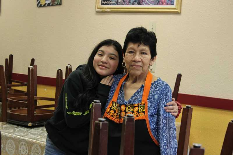 PAT KRUIS/MADRAS PIONEER  - Eulalia Burgos, right, owns La Cabanita, a Madras restaurants that has remained closed to in-house dining. Pictured with her is her granddaughter, Katlyn Salgado.