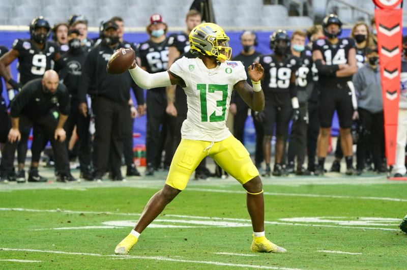 COURTESY PHOTO: PLAYSTATION FIESTA BOWL - For the first time all season, Anthony Brown split time at quarterback with Tyler Shough in the Fiesta Bowl. Brown ran for two touchdowns, but the Oregon offense struggled to sustain drives in the loss to Iowa State.