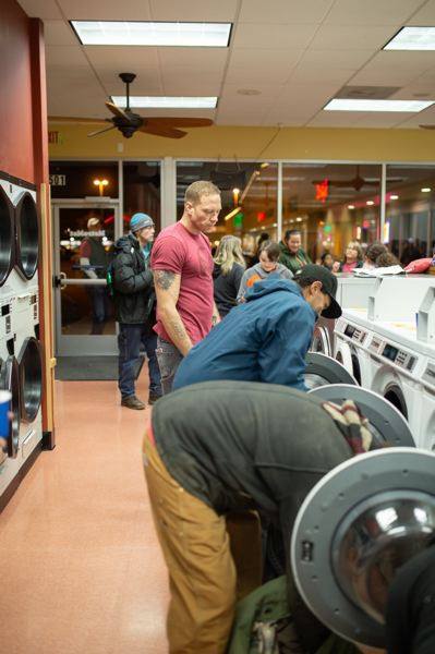 CONTRIBUTED PHOTO: TJ DAVIS - Twice a month, volunteers with Gresham Laundry Love wash clothes and bedding for low-income and homeless residents.