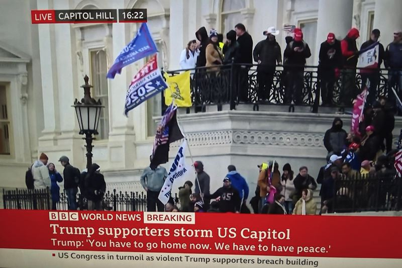 SCREENSHOT - Images from England's BBC news channel, as the siege of the U.S. Capitol becomes international news. President Trump went on the air around 1:20 p.m. and fraudulently said the election had been stolen from him, despite a lack of any evidence.