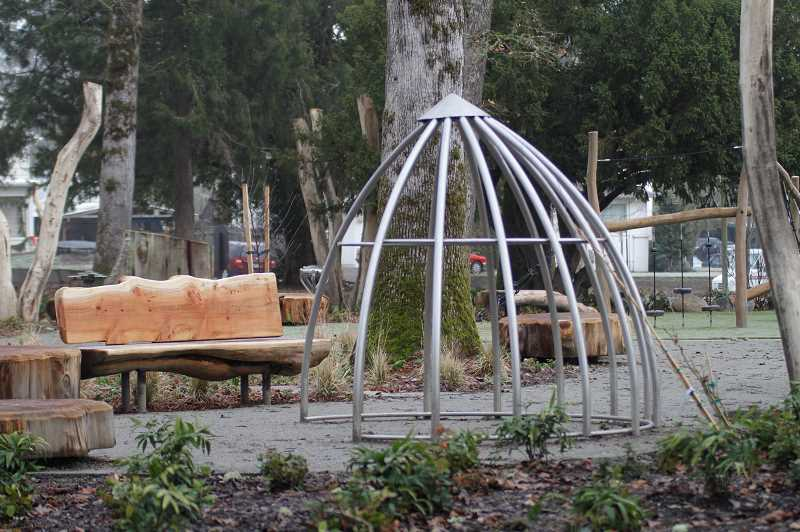 PMG PHOTO: WADE EVANSON - Benches and play structures litter Anna and Abby's Yard in Rogers Park in Forest Grove. The playground was built in honor of Anna Dieter-Eckert and Abigail Dieter-Robinson, who died in 2013.
