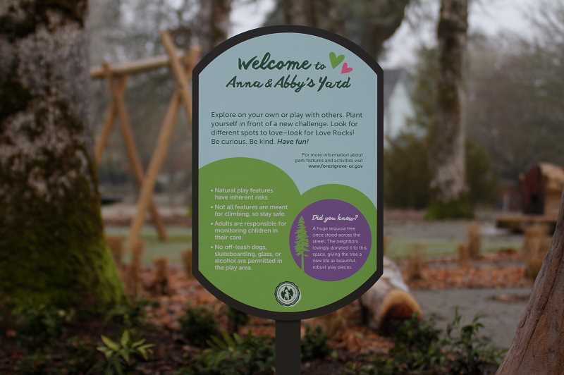 PMG PHOTO: WADE EVANSON - A sign in Rogers Park welcomes visitors to Anna and Abby's Yard. The sign offers safety instructions and background information on the playground's namesakes.