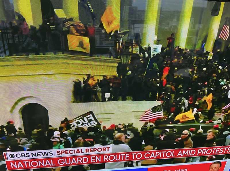 PMG SCREENSHOT - A screen capture from CBS news of rioters on the steps of the U.S. Capitol, Wednesday, Jan. 6.