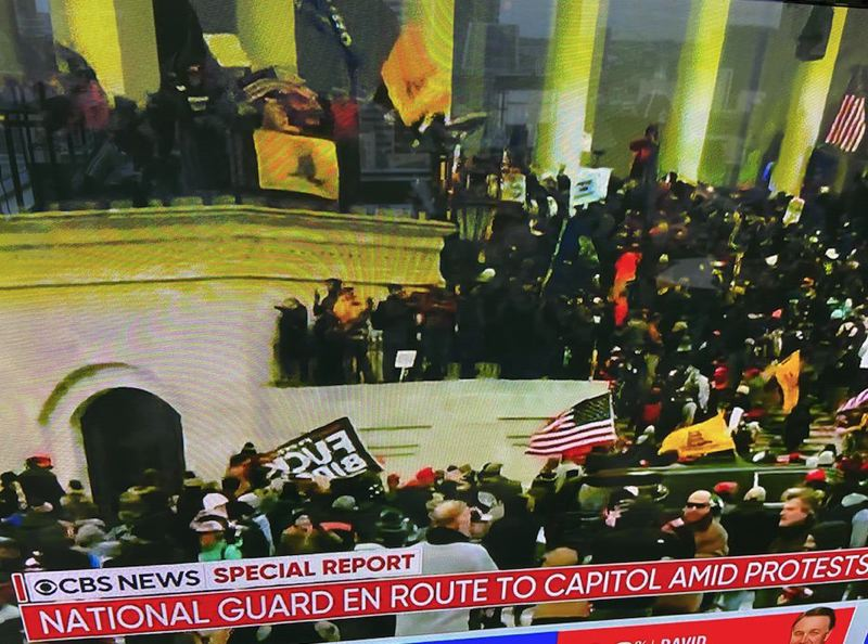SCREENSHOT - Screenshot from CBS News of rioters at the U.S. Capitol Jan. 6.