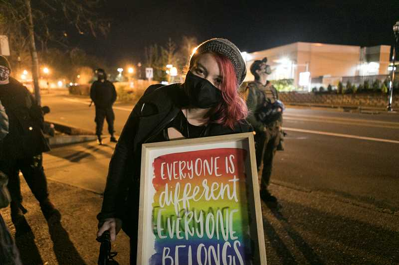 PMG PHOTO: JAIME VALDEZ - Cyncyrie Cruz attends a protest march in Tigard calling for an end to police responding to calls involving mentally unstable people. The march took place the day after police in Tigard killed a man who reportedly was having a manic episode.