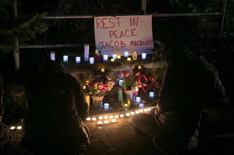 PMG PHOTO: JAIME VALDEZ - A roadside vigil is held for Jacob McDuff, who was shot and killed by police in Tigard on Wednesday, Jan. 6.
