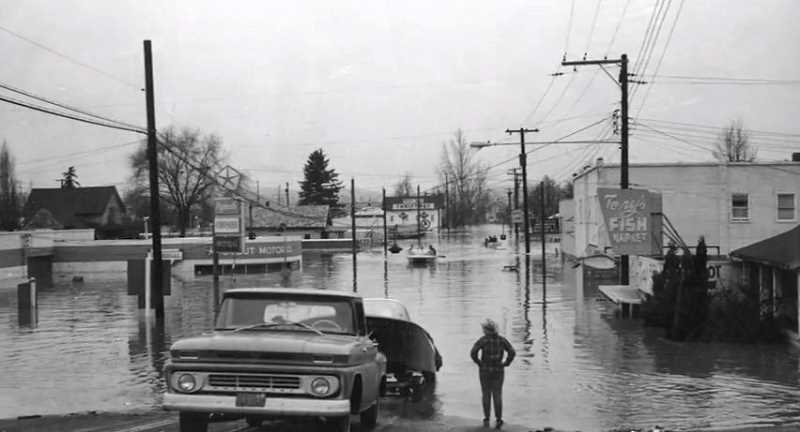 PHOTO COURTESY: CLACKAMAS COUNTY - Downtown Oregon City is accessible only by boat during the Christmas 1964 flood.