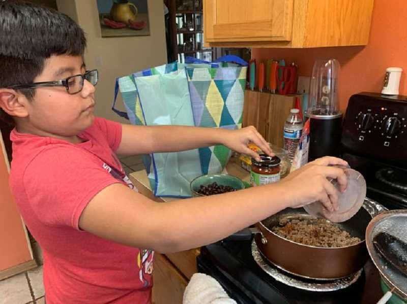 PHOTO COURTESY OF JEFFERSON COUNTY COMMUNITY LEARNING CENTER - A student makes Walking Tacos as part of the Jefferson County Community Learning Center's Cooking Dreams beginning cooking course for kids.
