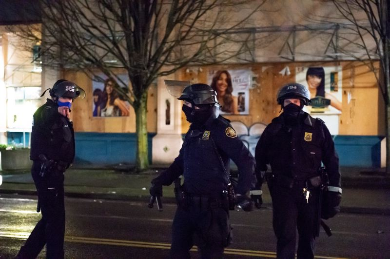 COURTESY PHOTO: SEAN BASCOM - A Portland Police Bureau sergeant, with helmet number 506, points at freelance photographer Sean Bascom shortly before his arrest outside the North Precinct just before midnight Jan. 5.