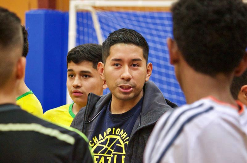 PMG FILE PHOTO - Ricki Ruiz working with young people. He not only is one of the Legislature's youngest representatives, he also has served on a school board.